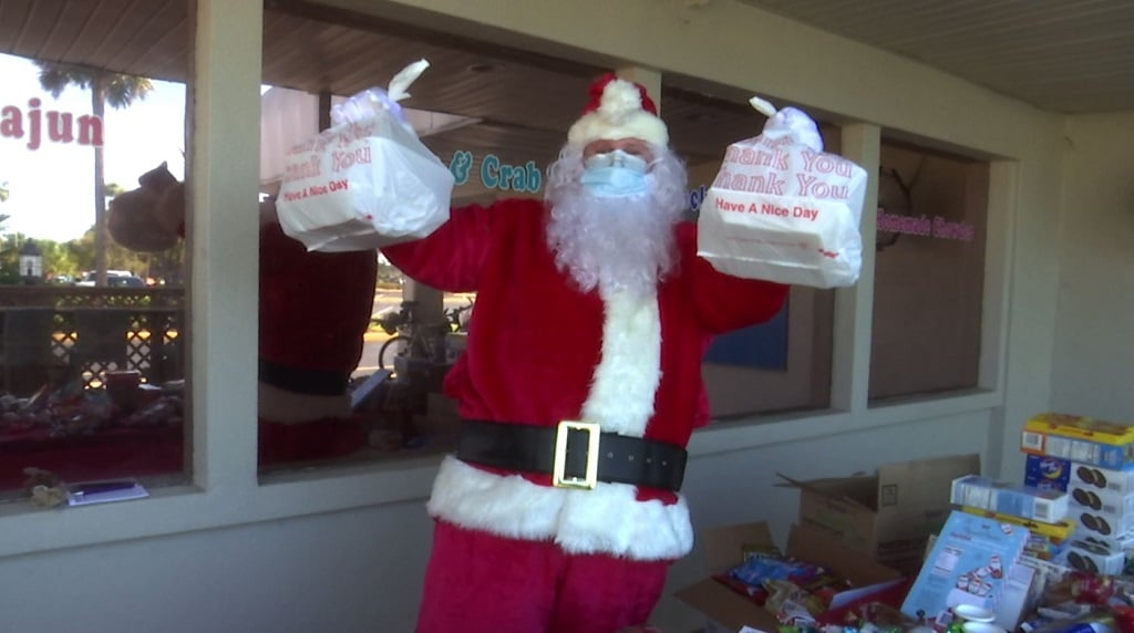 Families enjoy the free Christmas dinner at Fort Myers Restaurant