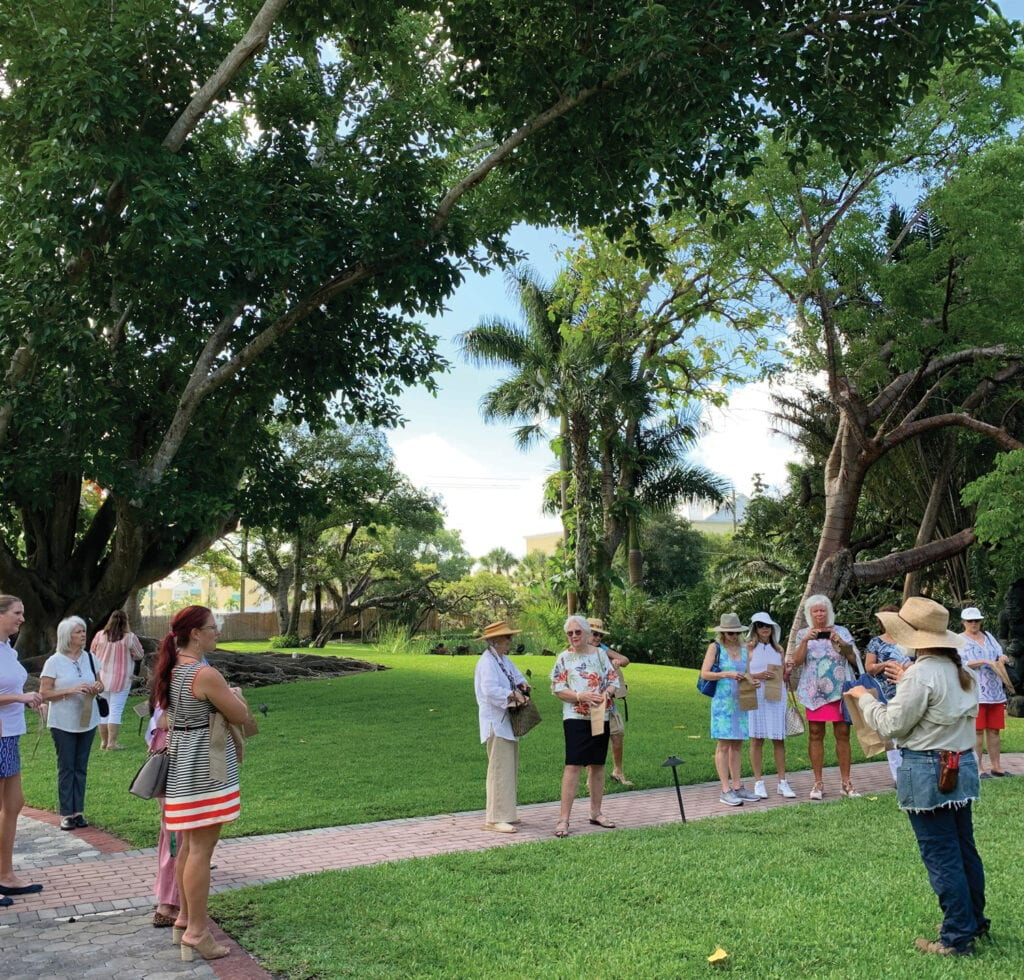 Cecelia Morales speaks to guests during a garden tour of Shangri-La Springs.