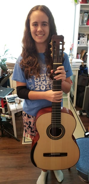 Paloma Chaprnka, who won her age group at the Houston Classical Guitar Festival and Competition