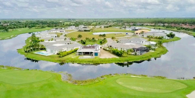 The Treviso Bay peninsula is completely surrounded by a lake, with the municipality's TPC golf course just behind it.
