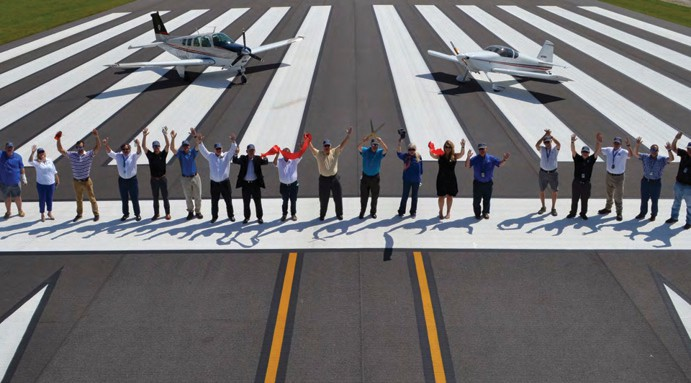 Officials mark the completion of a major project at the Punta Gorda Airport. PGD's Runway 15-33 Rehab & Extension was recently named FDOT's 2021 Commercial Service Airport Project of the Year. COURTESY PHOTO