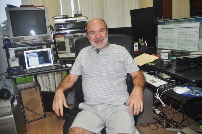 Alex Goldstein sits in his studio in north Naples. Here he composes and composes music for Olympic athletes.