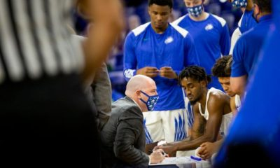 FGCU head coach Michael Fly talks to his players during a time out during the FGCU men's basketball season opener against Florida A&M at Alico Arena at FGCU in Fort Myers on Wednesday, November 25, 2020. FGCU beat Florida A&M 65-56.