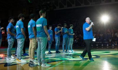 FGCU men's basketball coach Michael Fly addresses the crowd with his team during the Eagle Revolution in the FGCU's Alico Arena on Thursday evening, August 19, 2021.