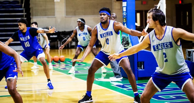 Members of the FGCU men's team, including Kevin Samuel (center right) and Caleb Catto (right), will train at the Alico Arena on Tuesday, September 28, 2021.